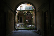 An abandoned palace in the historical center city. On 6 April 2009 a strong earthquake hit the city of L'Aquila, in the central Abruzzo region of Italy, leaving 308 dead and tens of thousand homeless. 4  years after In the historical center of the city few signs of reconstructions could be seen. On the other hand the effects of the of abandonment add up to the destruction of the quake. .
