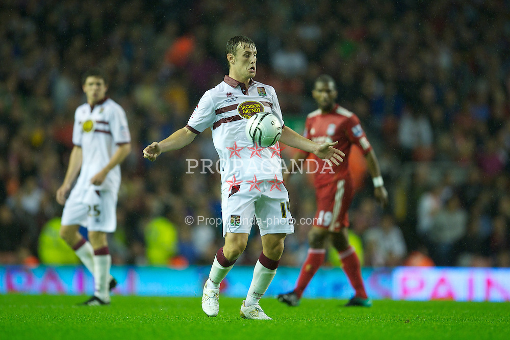 LIVERPOOL, ENGLAND - Wednesday, September 22, 2010: Northampton Town's John Johnson in action against Liverpool during the Football League Cup 3rd Round match at Anfield. (Photo by David Rawcliffe/Propaganda)