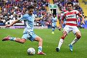 Coventry City midfielder (on loan from Aston Villa) Callum O'Hare (17) gets a cross away under pressure from Doncaster Rovers defender Reece James (3) during the EFL Sky Bet League 1 match between Coventry City and Doncaster Rovers at the Trillion Trophy Stadium, Birmingham, England on 28 September 2019.