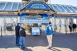 © Licensed to London News Pictures. 22/03/2020. Brighton, UK. The Brighton Palace Pier closed it gates to visitors as the UK government instructed the closure of all pubs, bars, clubs, and many more outlets. Photo credit: Hugo Michiels/LNP