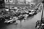 17/03/1964<br /> 03/17/1964<br /> 17 March 1964<br /> St. Patrick's Day Parade, Dublin.  Hickey Boats (Galway) in the parade passing Westmoreland Street and across O'Connell Bridge.