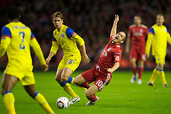 LIVERPOOL, ENGLAND - Thursday, September 16, 2010: Liverpool's Joe Cole is brought down by FC Steaua Bucuresti's Eric Bicfalvi during the opening UEFA Europa League Group K match at Anfield. (Photo by David Rawcliffe/Propaganda)