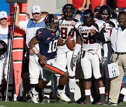 Virginia quarterback Jameel Sewell (10) rushes along the Texas Tech sidelines.  The Texas Tech Red Raiders defeated the Virginia Cavaliers 31-28 in the 2008 Konica Menolta Gator Bowl held at the Jacksonville Municipal Stadium in Jacksonville, FL on January 1, 2008.