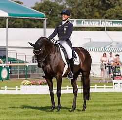 Land Rover Burghley Horse Trials. <br /> Ingrid Klimke and FRH BUTTS ABRAXXAS during the Dressage phase, Burghley House, Stamford, UK, Thursday, 5th September 2013. Picture by Nico Morgan / i-Images.