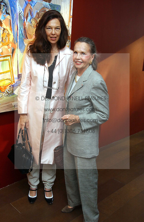 Left to right, JENNY WILHIDE and actress LESLIE CARON at a private view of artist Damian Elwes work 'Artists Studios' held at Scream, 34 Bruton Street, London W1 on 29th June 2006.<br /><br />NON EXCLUSIVE - WORLD RIGHTS