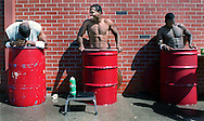 San Francisco 49er rookies (from left to right)  Chafie Fields, London Dunlap, and John Keith take a dip in barrels full of ice and water after the first day of training camp at University of the Pacific in Stockton, CA..Examiner/Jakub Mosur...July 16, 2000