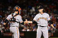 PHOENIX, AZ - MAY 14:  Cory Gearrin #62 of the San Francisco Giants is congratulated by Buster Posey #28 after closing out the game against the Arizona Diamondbacks at Chase Field on May 14, 2016 in Phoenix, Arizona.  The San Francisco Giants won 5-3.  (Photo by Jennifer Stewart/Getty Images)