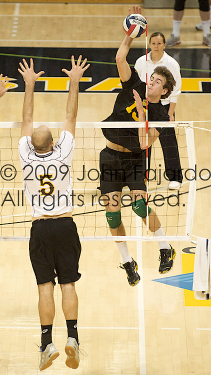 03Jan09 Long Beach, CA-  Ben Saxton tries to hit past the  block of Mike Klipsch.  Alberta lost the match to the 49ers three games to one.