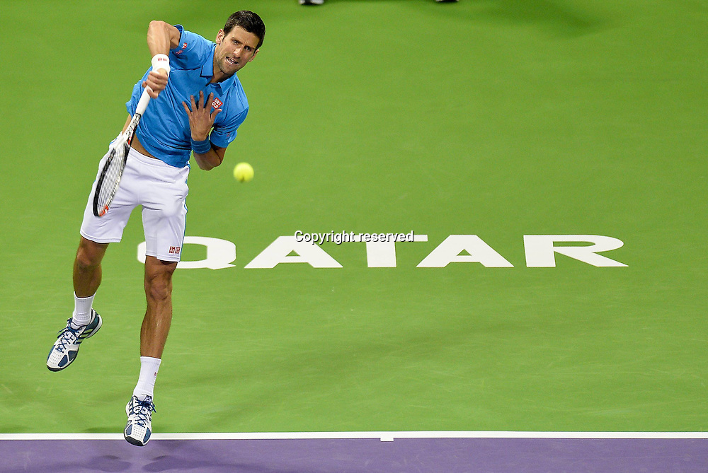 07.01.2017. Doha, Qatar. Novak Djokovic of Serbia serves to Andy Murray of Britain during the men's singles final of the ATP Tennis Herren Qatar Open tennis tournament at the Khalifa International Tennis Complex in Doha.