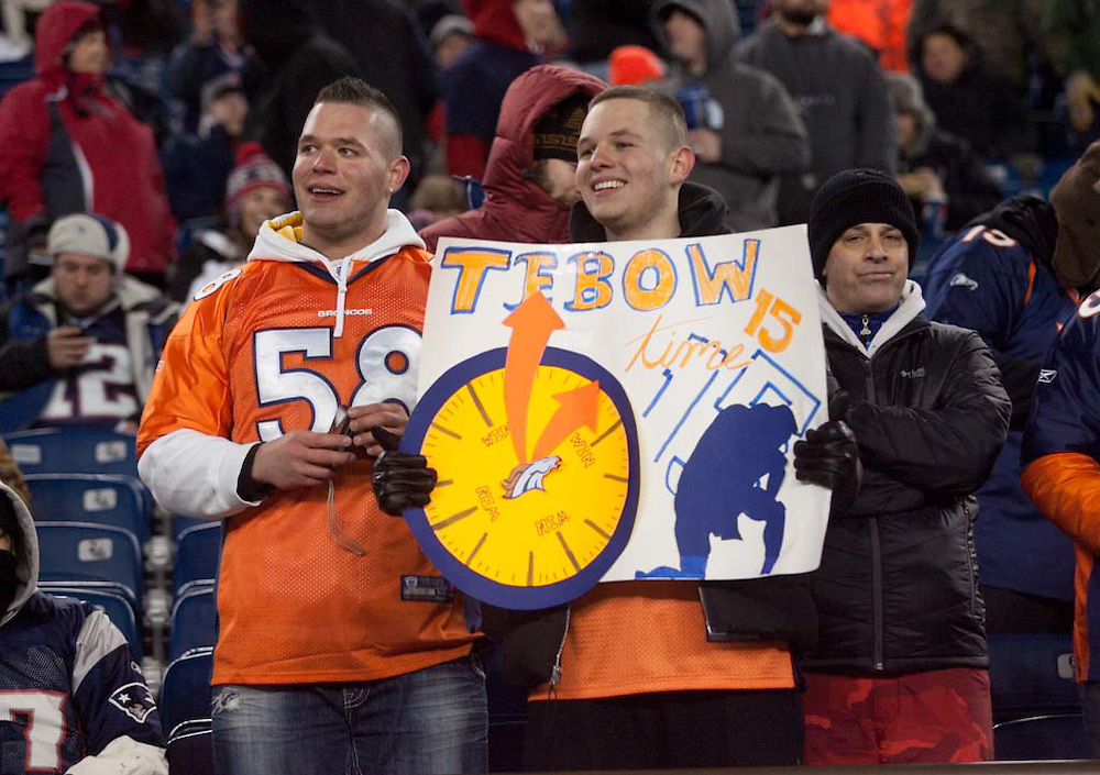 Foxborough, MA 01/14/2012.Denver fans Alex Nedoshitko, left, and his brother Mike, at right, cheer during the first half of Saturday's AFC Divisional game between the New England Patriots and the Denver Broncos..Wicked Local Photo by Alex Jones