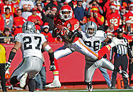 Sports Illustrated -- Wide receiver Dwayne Bowe #82 of the Kansas City Chiefs pulls in a pass against the Oakland Raiders during the first half at Arrowhead Stadium in Kansas City, Missouri.