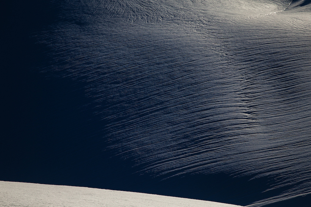 Patterns on snow made from rain and warm temperatures in the Coast Mountains, near Whistler, BC. Canada.