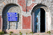 Signpost on The Stelvio Pass, Passo dello Stelvio, Stilfser Joch, in Northern Italy points to Bolzano, Santa Maria and Svizzera