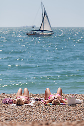 © Licensed to London News Pictures. 19/07/2016. Southsea, United Kingdom.  Two women sunbathe in the sunshine on the beach in Southsea this afternoon, 19th July 2016. Photo credit: Rob Arnold/LNP