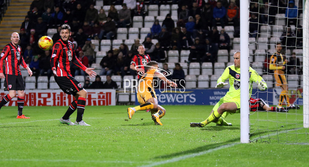 Barry Roach is tested during the Sky Bet League 2 match between Morecambe and Cambridge United at the Globe Arena, Morecambe, England on 24 November 2015. Photo by Pete Burns.