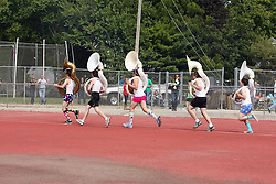 17 September 2011: Participants from the IWU band join in the fun at half-time by performing the traditonal race of the tubas dressed in flahy boxer shorts, A style t-shirts and colorful socks during an NCAA Division 3 football game between the Aurora Spartans and the Illinois Wesleyan Titans on Wilder Field inside Tucci Stadium in.Bloomington Illinois.