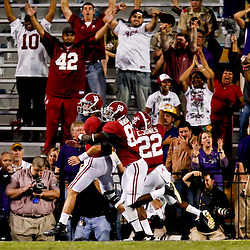 November 3, 2012; Baton Rouge, LA, USA;  Alabama Crimson Tide quarterback AJ McCarron (10) celebrates with  wide receiver Kevin Norwood (83) after a touchdown run during the first half of a game against the LSU Tigers at Tiger Stadium. Alabama defeated LSU 21-17.  Mandatory Credit: Derick E. Hingle-US PRESSWIRE