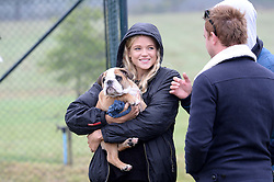 GABRIELLA ANSTRUTHER-GOUGH-CALTHORPE (Actress Gabriella Wilde) and her dog Ghost at the Ripley Football Tournament hosted by Irene Forte in aid of The Samaritans held at Ryde Farm, Hungry Hill Lane, Ripley, Surrey on 14th September 2013.  After the football guests enjoyed an after party.