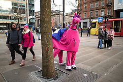 © Licensed to London News Pictures. 26/01/2019. Manchester, UK. Two men dressed as a pink unicorn in St Peter's Square . A cross party demonstration by hundreds of supporters of a People's Vote on Britain's membership of the EU is held in St Peters Square , followed by a march to the Mechanics Institute and rally of supporters . Photo credit: Joel Goodman/LNP