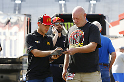 April 13, 2018 - Bristol, Tennessee, United States of America - April 13, 2018 - Bristol, Tennessee, USA: Kyle Larson (42) signs autographs for a fan before opening practice for the Food City 500 at Bristol Motor Speedway in Bristol, Tennessee. (Credit Image: © Chris Owens Asp Inc/ASP via ZUMA Wire)