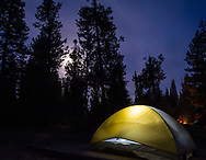 A tent lit up at night at the Jenny Lake campground in Grand Teton National Park, Wyoming.