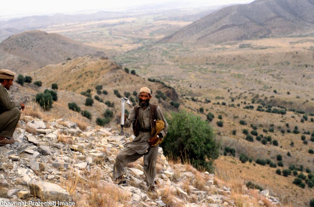 26 July 1985<br /> Mujahid on ridge with rocket dud. Etebari on left.