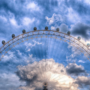 Set against a cloudy sky, the pods of the London Eye seem to barely move as the wheel goes round slowly.