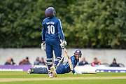 Scotland's Craig Wallace is all smiles after slipping during the One Day International match between Scotland and Afghanistan at The Grange Cricket Club, Edinburgh, Scotland on 10 May 2019.