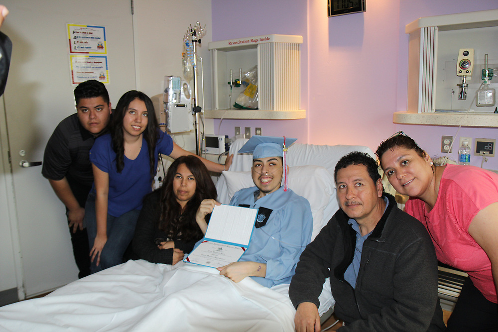 Madison HS senior Erick Reyes with his family at Texas Children's Hospital.