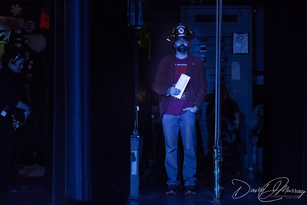 Joe Hill waits just off stage as he is introduced to speak about his book The Fireman at The Music Hall, May 16, 2016