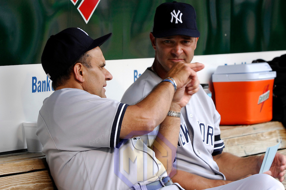 28 July 2007:  New York Yankees manager Joe Torre (L) talks with bench coach Don Mattingly in the dugout prior to the game against the Baltimore Orioles.  The Orioles defeated the Yankees 7-5 at Camden Yards in Baltimore, MD.   ****For Editorial Use Only****