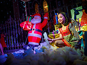 "23 DECEMBER 2018 - CHANTABURI, THAILAND: Children for photos with Santa in the ""North Pole"" at the Cathedral of the Immaculate Conception's Christmas Fair in Chantaburi. Cathedral of the Immaculate Conception is holding its annual Christmas festival, this year called ""Sweet Christmas @ Chantaburi 2018"". The Cathedral is the largest Catholic church in Thailand and was founded more than 300 years ago by Vietnamese Catholics who settled in Thailand, then Siam.   PHOTO BY JACK KURTZ"