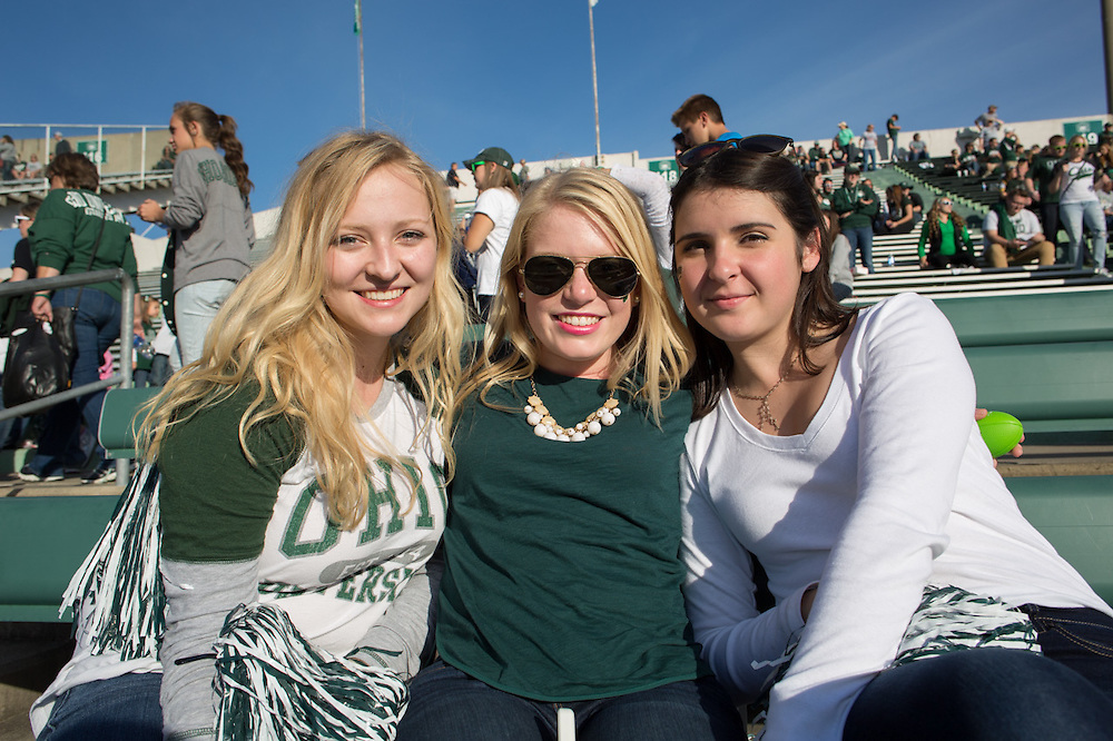 Ohio University freshmen Maia Hamilton, left, Emily Brunner, center, and Sara Izquierdo, right, pose for a picture at the Ohio University Homecoming game on October 10, 2015 at Peden Stadium. Photo by Emily Matthews