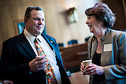 Montana Senator Jon Tester (D) speaks with Ardelle Watkins of Great Falls during a constituant coffee hour on Capitol Hill.