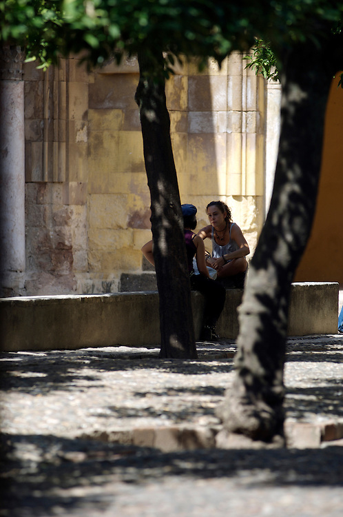 Young couple talking together outside the Mesquita cathedral Cordoba Andalucia, Spain
