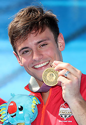 England's Tom Daley with his gold medal in the Men's Synchronised 10m Platform Final at the Optus Aquatic Centre during day nine of the 2018 Commonwealth Games in the Gold Coast, Australia.