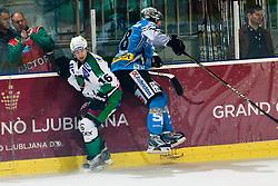 Ales Music (HDD Tilia Olimpija, #16) and Andreas Reisinger (EHC Liwest Black Wings Linz, #28) during ice-hockey match between HDD Tilia Olimpija and EHC Liwest Black Wings Linz in 19th Round of EBEL league, on November 7, 2010 at Hala Tivoli, Ljubljana, Slovenia. (Photo By Matic Klansek Velej / Sportida.com)