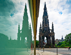 Scott Monument and an empty Princes Street reflected in shop window during covid-19 lockdown, Edinburgh, Scotland, UK