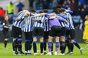 Sheffield Wednesday in a team huddle before kick off of the EFL Sky Bet Championship match between Sheffield Wednesday and Swansea City at Hillsborough, Sheffield, England on 9 November 2019.