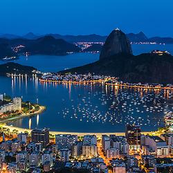 Sugarloaf mountain and the city of Rio de Janeiro at night, Rio de Janeiro, Brazil.