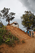 "January 2008, Kolwezi, DRC. This phone ""cabine"" is built on top of a termite mound, the only place in the informal settlement that has a consistent cell phone signal."