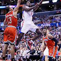 24 March 2014: Los Angeles Clippers guard Darren Collison (2) goes for the layup past Milwaukee Bucks guard Ramon Sessions (13) during the Los Angeles Clippers 106-98 victory over the Milwaukee Bucks at the Staples Center, Los Angeles, California, USA.
