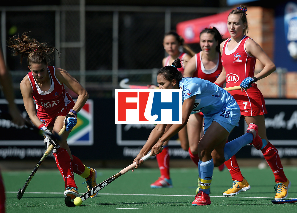 JOHANNESBURG, SOUTH AFRICA - JULY 12: Rani of India and Camila Caram of Chile battle for possession  during day 3 of the FIH Hockey World League Semi Finals Pool B match between India and Chile at Wits University on July 12, 2017 in Johannesburg, South Africa. (Photo by Jan Kruger/Getty Images for FIH)