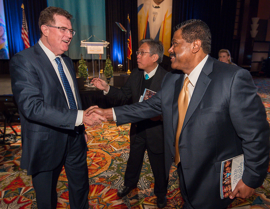 Superintendent Dr. Terry Grier, left, greets guests following his address during the Houston ISD State of the Schools luncheon at the Hilton of the Americas, February 26, 2014.