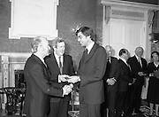 New Government Receive Seals Of Office.   (N84)..1981..30.06.1981..06.30.1981..30th June 1981..The newly elected Fine Gael /Labour coalition government under Dr Garret Fitzgerald received their seals of office from President Hillery at Áras an Uachtaráin today...Mr Alan Dukes TD is pictured accepting his seal of office as Minister for Agriculture from President Hillery at the Áras today.