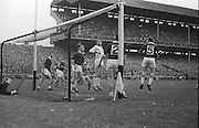 E Colleran and J Donnellan were not high enough to stop this Kerry Point in  the second half during the All Ireland Senior Gaelic Football Championship Final, Kerry vs Galway in Croke Park on the 27th September 1964. Galway 0-15 Kerry 0-10.
