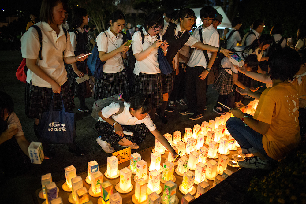 NAGASAKI, JAPAN - AUGUST 8 : Students participate in making candle-lit paper lanterns at Nagasaki Peace Park on the eve ahead of the 71st anniversary activities, commemorating the atomic bombing of Nagasaki on August 8, 2016 in Nagasaki, southern Japan. On August 9, 1945, during World War II, the United States dropped the second Atomic bomb, a plutonium implosion-type bomb on Nagasaki city, killing an estimated 40,000 people which ended the World War II. (Photo by Richard Atrero de Guzman/NURPhoto)