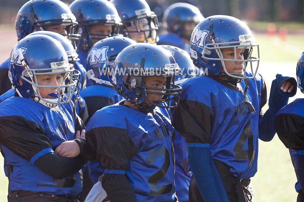 Newburgh, New York - Middletown players watch from the sideline during the Orange County Youth Football League Division II Super Bowl at Newburgh Free Academy on Nov. 22, 2014.