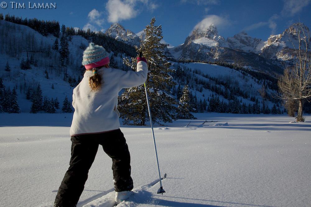 Jessica Laman (age 9)  cross-country skiing below the Teton Range.<br />Grand Teton National Park, Wyoming