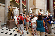 A tour stops by the Samuel Jordan Kirkwood statue in National Statuary Hall in the United States Capitol building in Washington, D.C. on Monday, June 27, 2011.
